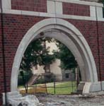 Arch with brick veneer and precast banding